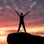 Happy person enjoying sunrise-The Positive Edge