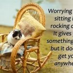 Worry quote with cat on rocking chair